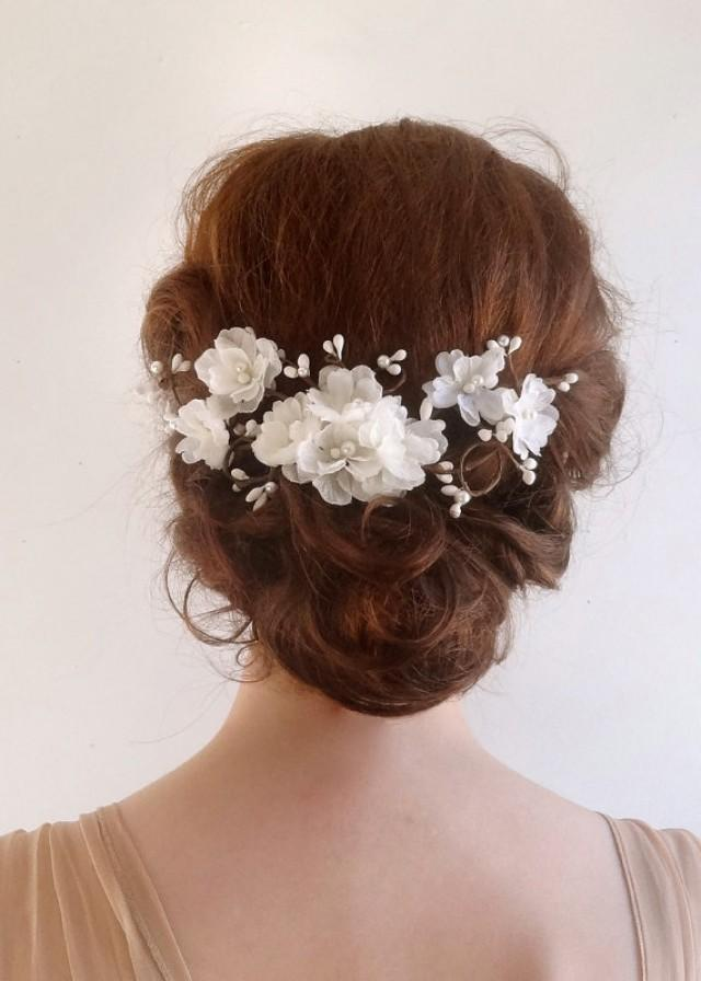 High quality bridal hair flowers on combs adorned with crystals, pearls or rhinestones.