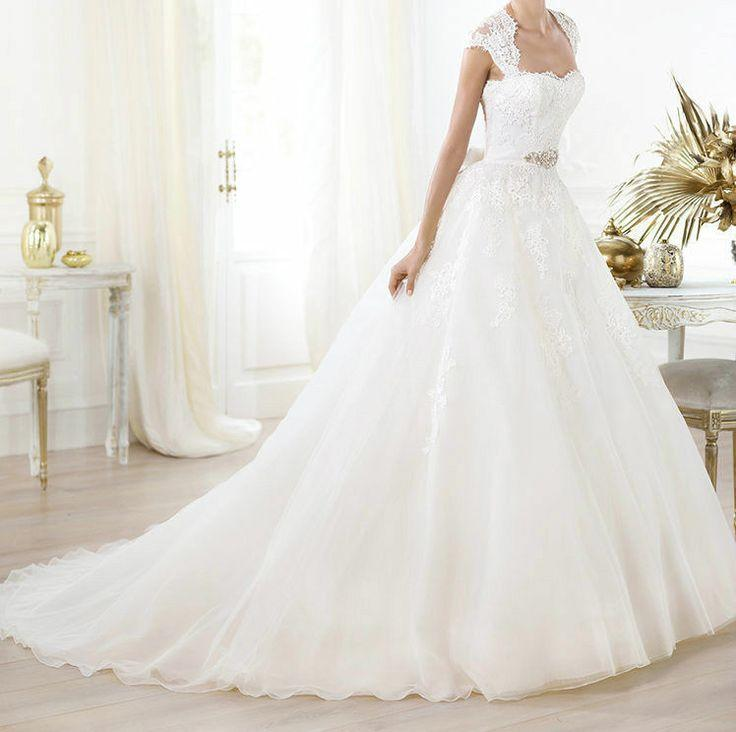 Wedding - White colored wedding gown with heavy flair at the bottom.